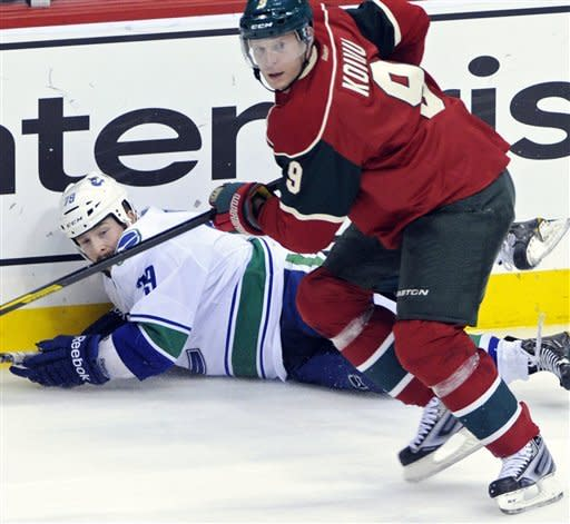 Sedin twins both score as Canucks beat Wild 5-2