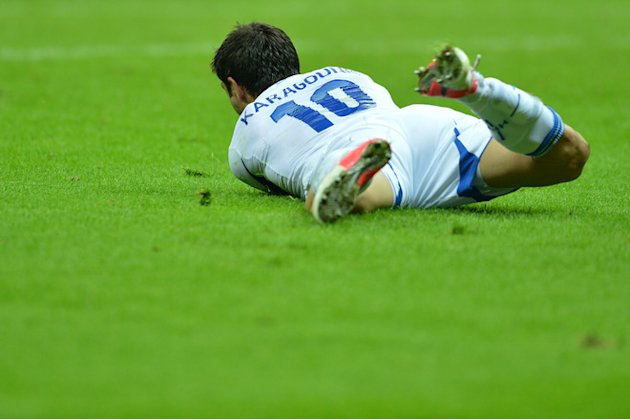 Greek Midfielder Kostas Katsouranis Falls AFP/Getty Images