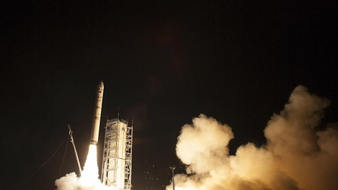 In this photo provided by NASA, an unmanned Minotaur rocket carries NASA's newest robotic explorer, the LADEE spacecraft, which is charged with studying the lunar atmosphere and dust, after launching to the moon from NASA's Wallops Flight Facility on Virginia's Eastern Shore on Friday, Sept. 6, 2013. (AP Photo/NASA, Carla Cioffi)