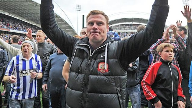 Barnsley's Manager David Flitcroft celebrates his team staying up (PA)