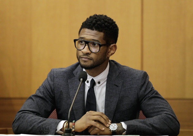 FILE - Hip-hop artist Usher Raymond takes the witness stand in court in a legal battle with his ex-wife in a custody fight involving their two sons in this May 22, 2012 file photo taken in Atlanta. Willie A. Watkins funeral home in Atlanta confirmed Saturday July 21, 2012 it is handling funeral arrangements for 11-year-old Kirk Glover. He was the son of Usher&#39;s ex-wife Tameka Foster. The boy was run over July 6 by a personal watercraft on Lake Lanier, according to the Georgia Department of Natural Resources. (AP Photo/David Goldman, File)