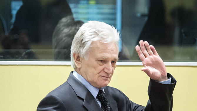 Gen. Momcilo Perisic, the former chief of staff of the Yugoslav national army, enters the court room of the Yugoslav war crimes tribunal for his appeal judgment in The Hague, Netherlands, Thursday Feb. 28, 2013. Prosecutors accused Perisic of providing crucial military aid to rebel Serb forces responsible for the atrocities including the Srebrenica massacre and siege of Sarajevo. Perisic's 2011 conviction and 27-year sentence marked the first time the U.N. court had found a civilian or military officer from Serbia guilty of war crimes in Bosnia. (AP Photo/Koen van Weel, Pool)
