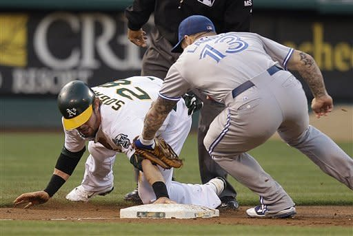 Colon pitches A's past slumping Blue Jays 4-1