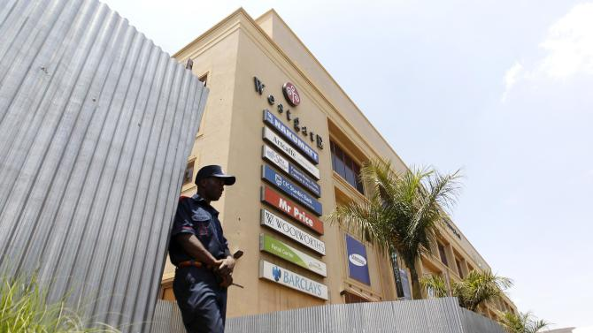 A security guard stands outside the Westgate shopping mall that has been left deserted following last year's attack by gunmen in Nairobi