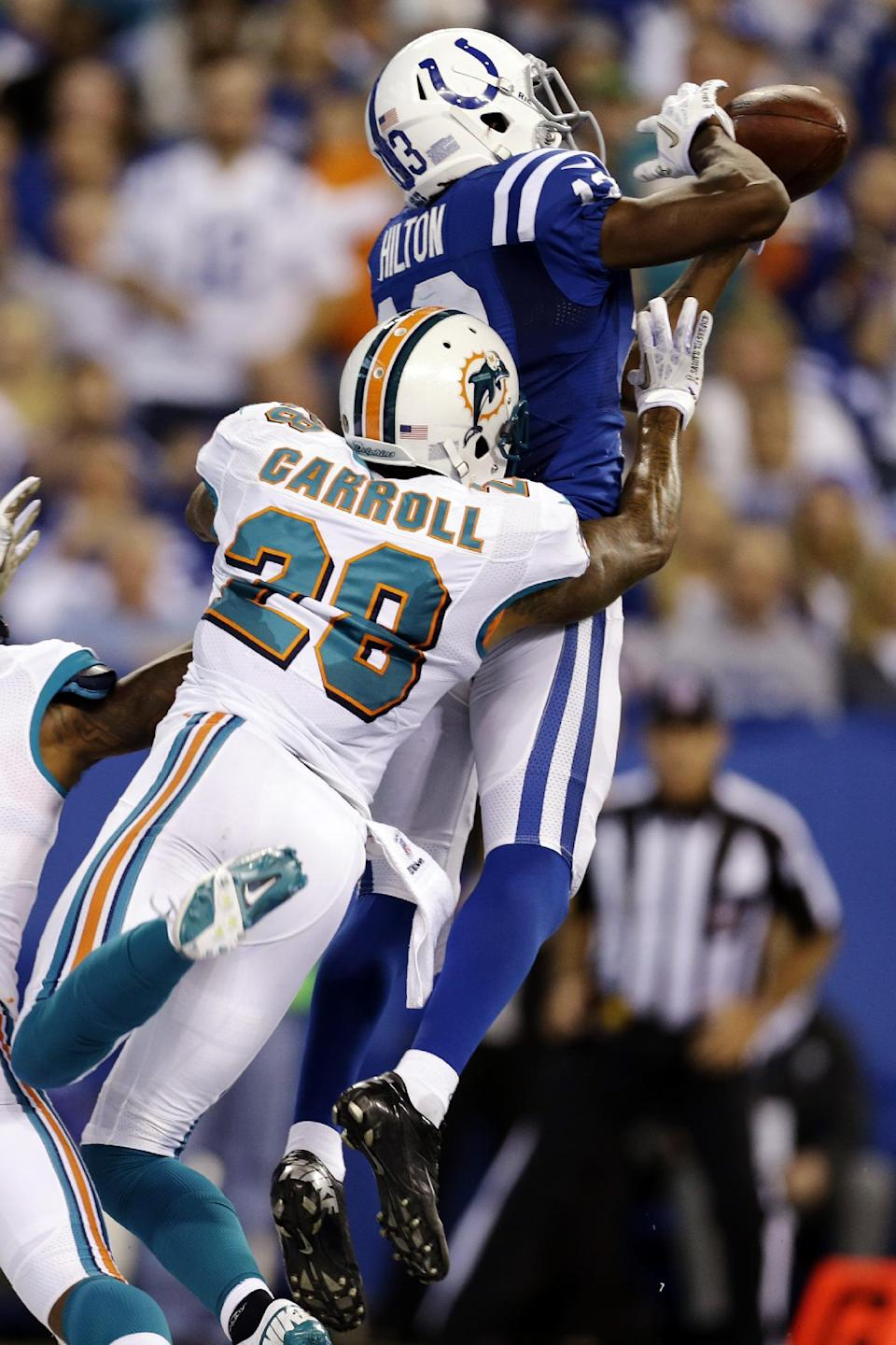 Indianapolis Colts wide receiver T.Y. Hilton, top, makes a catch for a touchdown over Miami Dolphins cornerback Nolan Carroll during the second half of an NFL football game in Indianapolis, Sunday, Nov. 4, 2012. (AP Photo/Darron Cummings)