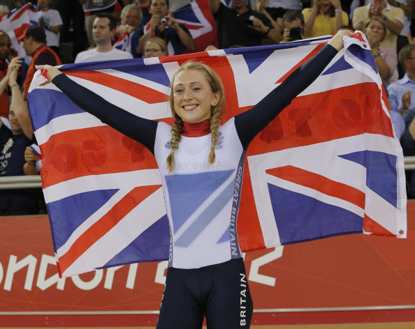 Britain&#39;s Laura Trott celebrates after winning the gold medal in the track cycling women&#39;s omnium event, at the 2012 Summer Olympics, Tuesday, Aug. 7, 2012, in London. (AP Photo/Christophe Ena)