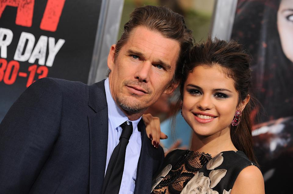 "Actor Ethan Hawke, left, and actress/singer Selena Gomez arrive at the premiere of ""Getaway"" at the Regency Village Theater on Monday, Aug. 26, 2013 in Los Angeles. (Photo by Jordan Strauss/Invision/AP)"