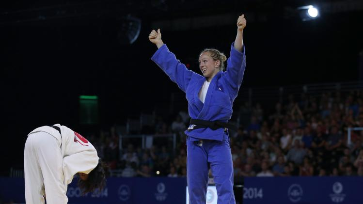 Conway of Scotland celebrates after beating Huidrom of India in their women's -70kg weight category bronze medal judo matchh at the 2014 Commonwealth Games in Glasgow