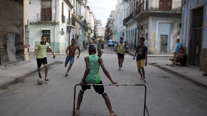 Children play soccer in downtown Havana