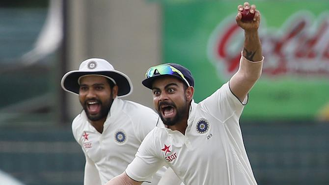 India's captain Kohli celebrates with Sharma after taking the catch to dismiss Sri Lanka's Chandimal during the fourth day of their third and final test cricket match in Colombo