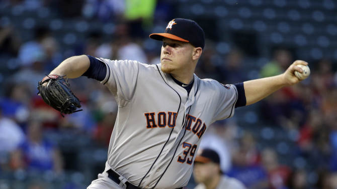 Martinez gets 1st home win as Rangers beat Astros