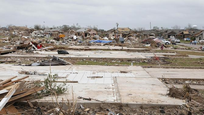 All that is left of homes is a row of slabs following Moore's tornado and debris clean-up, in the Plaza Towers neighborhood in Moore, Okla., Monday, May 27, 2013. (AP Photo/Sue Ogrocki)