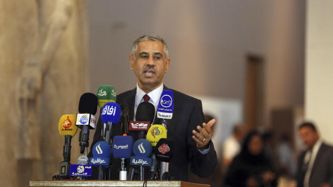 Iraqi Tourism and Antiquities Minister Adel Shirshab speaks during a press conference at the Iraq National Museum in Baghdad, Iraq, Wednesday, July 29, 2015. Nearly 400 artifacts looted from Iraq amid the chaos of the 2003 U.S.-led invasion that toppled former Iraqi President Saddam Hussein were recovered by the Iraqi authorities recently from several sources. (AP Photo/Khalid Mohammed)