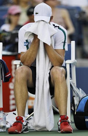 Andy Roddick reacts during a quarterfinal match against Rafael Nadal of Spain at the U.S. Open tennis tournament in New York, Friday, Sept. 9, 2011. (AP Photo/Matt Slocum)