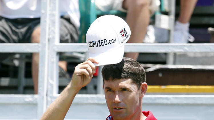 Padraig Harrington tips his hat in thanks to the applause prior to hitting from the first tee in the second round of the St. Jude Classic golf tournament Friday, June 7, 2013, in Memphis, Tenn. (AP Photo/Rogelio V. Solis)