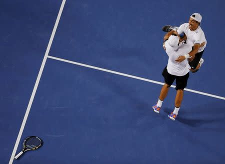 Bolelli and Fognini of Italy celebrate after defeating Herbert and Mahut of France in their men's doubles final match at the Australian Open 2015 tennis tournament in Melbourne