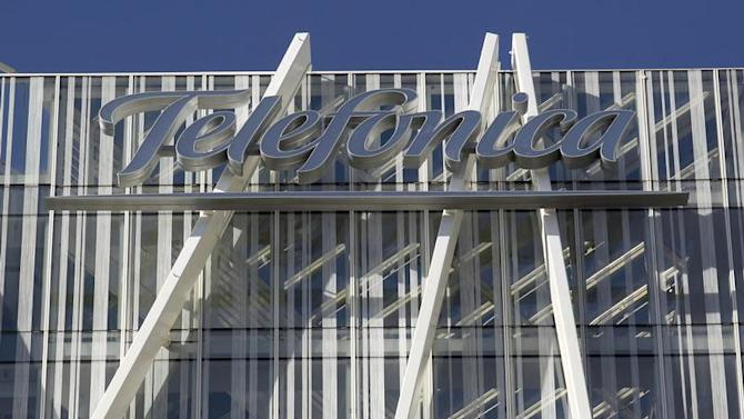 Telefonica's logo is seen on top of Telefonica's tower in Barcelona