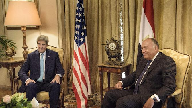 U.S. Secretary of State John Kerry, left, speaks with Egypt's Foreign Minister Sameh Shoukry, before a meeting at the Ministry of Foreign Affairs in Cairo, Egypt, Sunday, Aug. 2, 2015. Kerry met Sunday with Egyptian officials in Cairo as part of a Mideast trip aimed at assuaging concerns over the nuclear deal between Iran and world powers. (Brendan Smialowski/Pool Photo via AP)