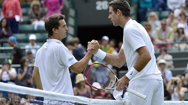 Juan Martin del Potro of Argentina (R) shakes hands with Albert Ramos of Spain after defeating him in their men's singles tennis match at Wimbledon (Reuters)