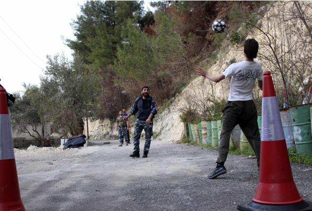 Free Syrian Army fighters play soccer in the Jabal al-Akrad area in Syria's northwestern Latakia province