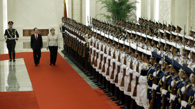 German Chancellor Angela Merkel, third from left, and Chinese Premier Wen Jiabao second from left, inspect a guard of honor during a welcome ceremony held at the Great hall of the People in Beijing Thursday, Aug. 30, 2012. (AP Photo/Ng Han Guan)