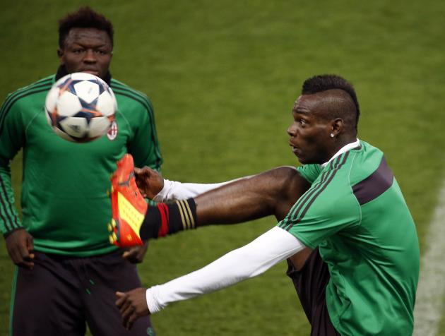 AC Milan's Mario Balotelli and Sulley Muntari take part in a training session at the Vicente Calderon stadium in Madrid