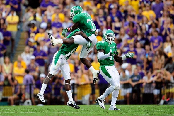 Zachary Orr #35 of the North Texas Mean Green celebrates a sack with teammates during a game against the LSU Tigers at Tiger Stadium on September 1, 2012 in Baton Rouge, Louisiana. LSU would win 41-14