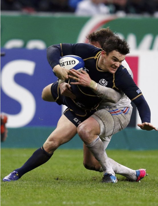 Scotland's Max Evans is tackled by France's Maxime Medard during their Six Nations rugby union match at the Stade de France in Saint-Denis