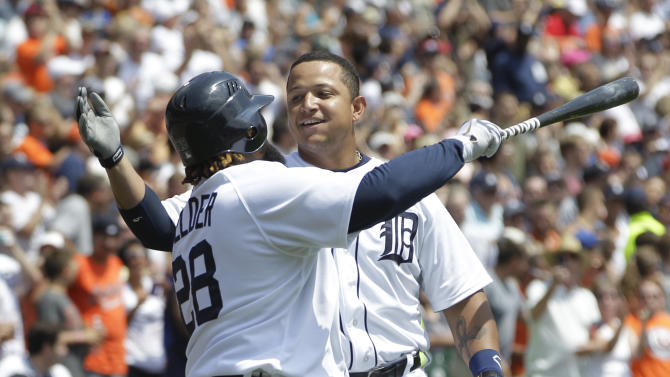 Detroit Tigers' Miguel Cabrera, right, hugs teammate Prince Fielder after hitting a home run during the third inning of a baseball game against the Chicago White Sox in Detroit, Sunday, July 22, 2012. (AP Photo/Carlos Osorio)