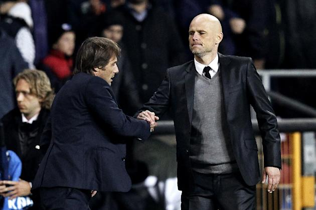 Juventus' coach Antonio Conte, left,  and FC Copenhagen's coach Staale Solbakken shake hands, after their Champions League Group B soccer match at Parken Stadium, Copenhagen, Denmark, Tuesday Sep. 17,