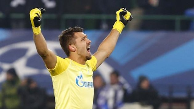 Zenit St Petersburg's goalkeeper Yuri Lodygin celebrates after his team scored against Austria Vienna (Reuters)