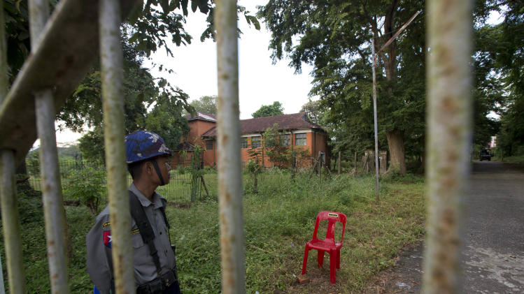In this picture taken on Saturday, Nov.17, 2012, a security officer stands guard at one of the entrances to Yangon University, where President Barack Obama is scheduled to deliver a speech on Monday, Nov. 19, 2012, in Yangon, Myanmar.  Since colonial times, the fight for change in Myanmar has begun on this leafy campus. It was a center of the struggle for independence against Britain and served as a launching point for pro-democracy protests in 1962, 1974, 1988 and 1996. For many, the school has today become a symbol of the country's ruined education system and a monument to a half century of misrule. (AP Photo/Gemunu Amarasinghe)