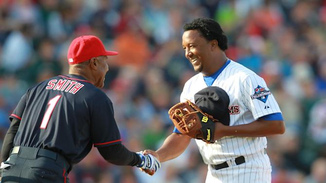 IMAGES DISTRIBUTED FOR PEPSI MAX - Ozzie Smith shakes hands with pitcher Pedro Martinez before batting at 2013 Pepsi MAX Field of Dreams Game on Saturday, May 18, 2013 in Rochester, NY. (Photo by Bill Wippert/Invision for Pepsi MAX/AP Images)
