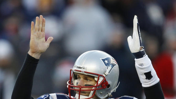 New England Patriots quarterback Tom Brady reacts against the Miami Dolphins during the second half of an NFL football game in Foxborough, Mass., Saturday Dec. 24, 2011. (AP Photo/Charles Krupa)