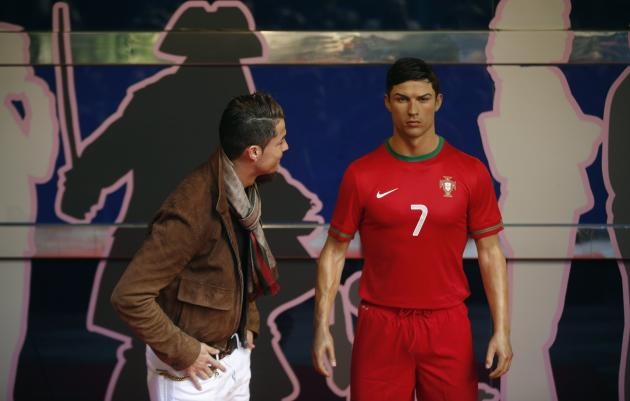 Cristiano Ronaldo, who plays for Real Madrid and Portugal's national soccer team, looks at his wax statue after an unveiling ceremony at the Madrid Wax Museum