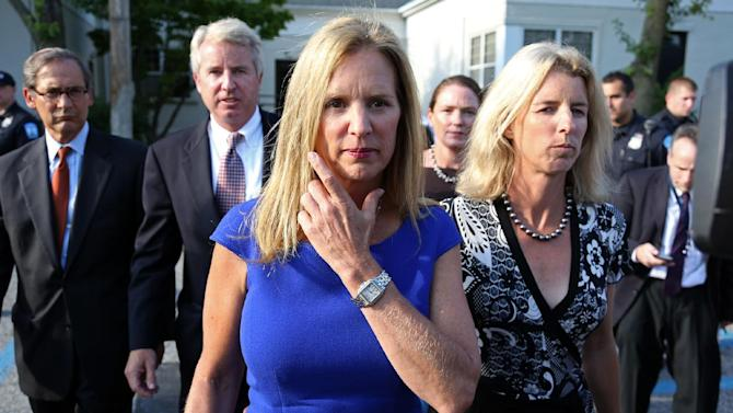 Kerry Kennedy, ex-wife of New York Gov. Andrew Cuomo, flanked by her brother Christopher Kennedy, center left, and sister Rory Kennedy, right, walks from  the North Castle Justice Court in Armonk, N.Y. Tuesday, July 17, 2012. Kennedy was arrested Friday after state police said her Lexus struck a tractor-trailer on Interstate 684 north of New York City. Police said she drove the damaged car off the highway before it became disabled. (AP Photo/Craig Ruttle)