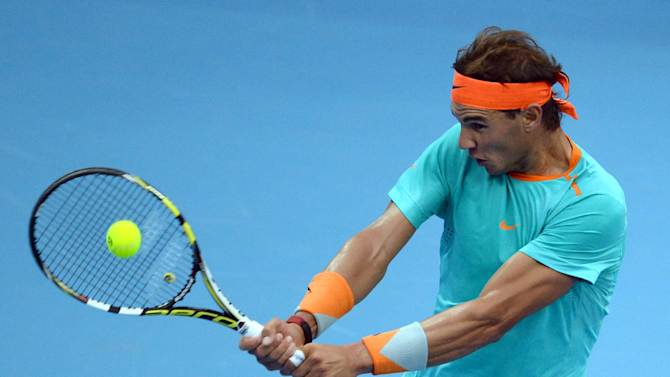 Rafael Nadal of Spain returns a shot against Richard Gasquet of France during the men's singles first round match at the China Open tennis tournament in the National Tennis Center of Beijing on September 30, 2014