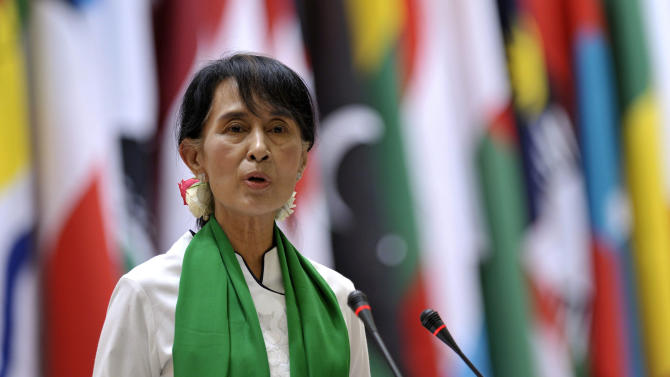 Myanmar opposition leader Aung San Suu Kyi speaks at a news conference during the annual meeting of the International Labour Organization (ILO) in Geneva, Switzerland, Thursday, June 14, 2012. Suu Kyi said that investment in her country should strengthen its nascent process of democratization. The Nobel peace laureate spoke Thursday to the annual meeting of the ILO in Geneva on the first stop of her trip to Europe. (AP Photo/Keystone, Martial Trezzini)