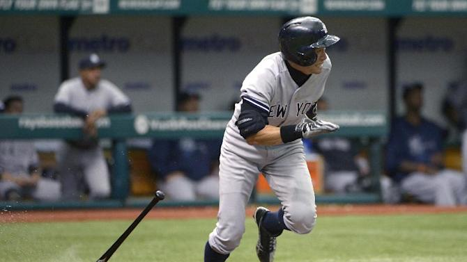 New York Yankees' Ichiro Suzuki heads to first base after singling during the sixth inning of a baseball game against the Tampa Bay Rays in St. Petersburg, Fla., Sunday, Aug. 25, 2013. (AP Photo/Phelan M. Ebenhack)