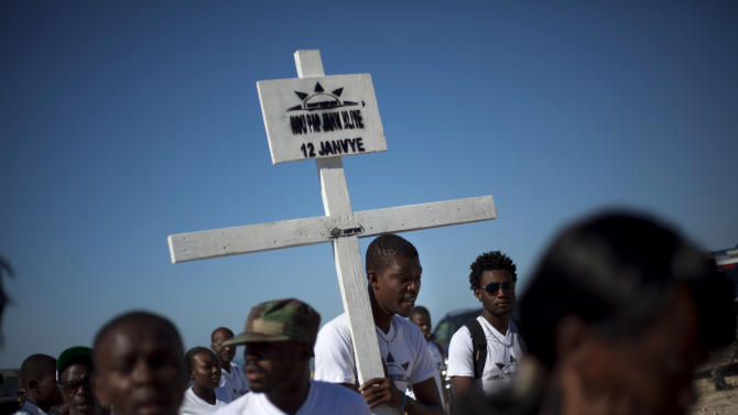 Relatives of those who died in the 2010 earthquake arrive for a memorial service at Titanyen, a mass burial site north of Port-au-Prince, Haiti, Saturday, Jan. 12, 2013. Haitians recalled the tens of thousands of people who lost their lives in a devastating earthquake three years ago, marking the disaster's anniversary Saturday with a simple ceremony. Haiti's previous presidential administration said 316,000 people were killed but no one really knows how many died.  (AP Photo/Dieu Nalio Chery)