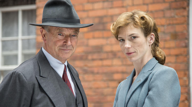 "Michael Kitchen, left, and Honeysuckle Weeks are shown from the series ""Foyle's War,"" premiering its new season on ""MASTERPIECE Mystery!"" on PBS on Sept. 15, 22, and 29. (AP Photo/PBS- ITV, Bernard Walsh)"