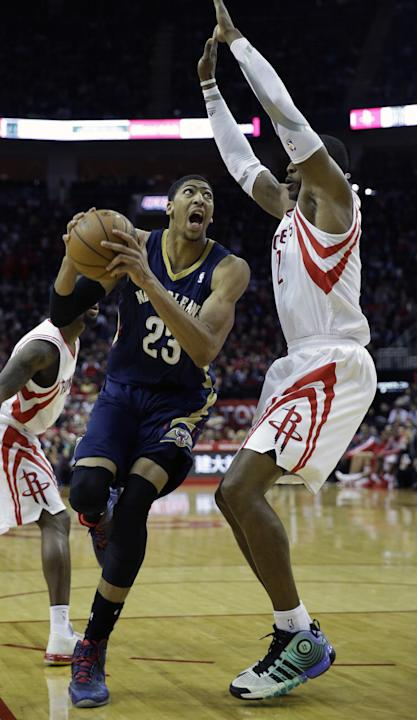 New Orleans Pelicans' Anthony Davis (23) looks to shoot as Houston Rockets' Dwight Howard (12) defends during the fourth quarter of an NBA basketball game on Saturday, Dec. 28, 2013, in Housto