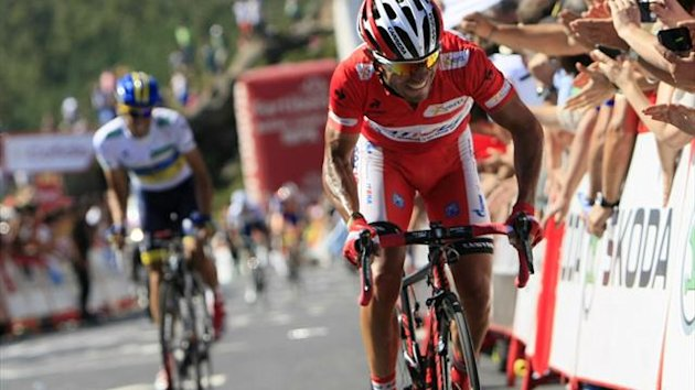 Katusha Team rider and leader of the race Joaquim &quot;Purito&quot; Rodriguez of Spain (R) and Team Saxo Bank rider Alberto Contador of Spain cycle during the 12th stage of the Tour of Spain &quot;La Vuelta&quot; cycling race, August 30 2012 (Reuters)