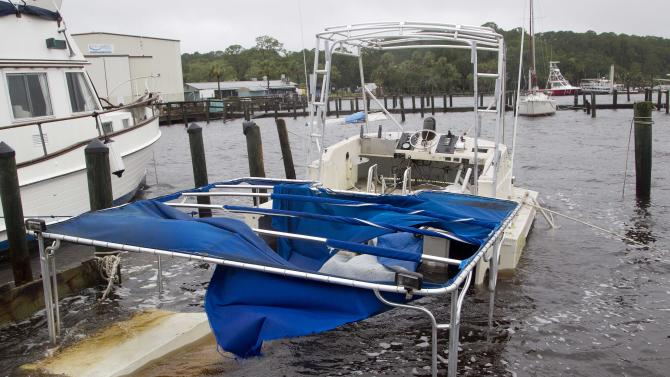 A pleasure boat sits battered and sunken at the Rock Landing Marina in Panacea, Fla., Tuesday, June 26, 2012. About a dozen boats were damaged by wind and rain from Tropical Storm Debby. (AP Photo/Dave Martin)