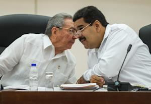Cuban President Raul Castro (left) talks to his Venezuelan …