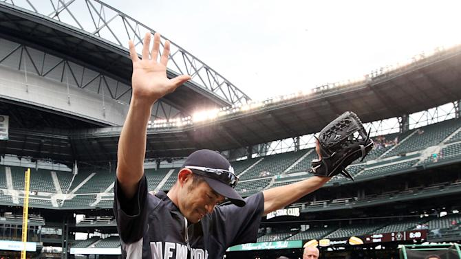 New York Yankees' Ichiro Suzuki waves to fans as he heads into the Yankees' dugout after briefly taking the field before a baseball game against the Seattle Mariners, Monday, July 23, 2012, in Seattle. The Mariners announced earlier in the day that Suzuki, who has played with the Mariners since 2001, was traded to the Yankees. (AP Photo/Elaine Thompson)
