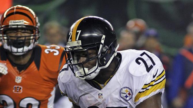 Pittsburgh Steelers running back Jonathan Dwyer (27) runs past Cincinnati Bengals defensive back Chris Crocker (33) during the second half of an NFL football game, Sunday, Oct. 21, 2012, in Cincinnati. Dwyer gained 122 yards in the game won by Pittsburgh 24-17. (AP Photo/Tom Uhlman)