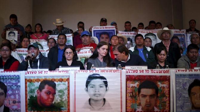 EAAF members, relatives of the 43 students missing from Ayotzinapa College Raul Isidro Burgos and representatives of human rights organisations take part in a news conference in Mexico City
