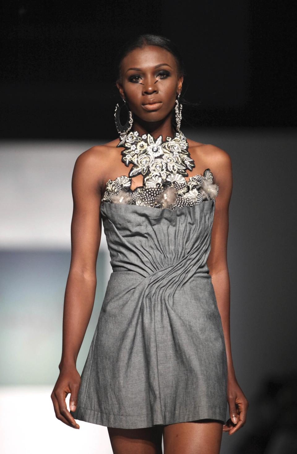 A model displays an outfit by designer Sunny Rose, during the MTN Fashion and Design Week in Lagos, Nigeria, Saturday, Oct. 27, 2012. (AP Photo/Sunday Alamba)