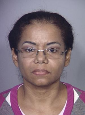 FILE - This undated booking photo provided by the Las Vegas Metropolitan Police Department shows Carmen Olfidia Torres-Sanchez, 47. Sanchez and Ruben Darion Matallana-Galvas, performed an illegal buttocks enhancement surgery that resulted in a Las Vegas woman's death. A spate of recent incidents, including this one death, has Nevada state health officials looking for better ways to deal with unlicensed health care providers.  (AP Photo/Las Vegas Metropolitan Police Department, File)